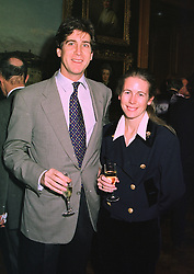 MR RUPERT & the HON.MRS SCOTT, she is the daughter of Lord Montagu of Beaulieu, at an exhibition in London on January 7th 1998.MEK 35