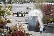 a young couple watches a fountain display at the Harborside Fountain Park, Bremerton, WA, USA