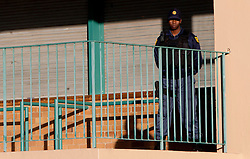 Policeman guarding at Slovenia training session at  Hyde Park High School Stadium on June 16, 2010 in Johannesburg, South Africa.  (Photo by Vid Ponikvar / Sportida)