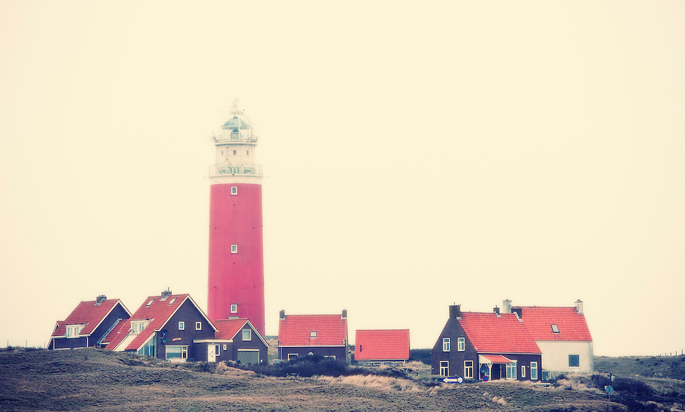 Lighthouse and houses north of de Cocksdorp, Texel, Netherlands