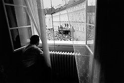 Prague, 5 June 1990 - Prague Castle.Vaclav Havel watches a public gathering of people who have come to congratulate him on being elected for the second time to the office of Czechoslovak President.