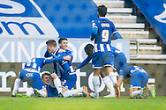 Alex Revell (3rd from left) of Wigan Athletic is mobbed by team mates after scoring the first goal during the Sky Bet League 1 match at the DW Stadium, Wigan<br /> Picture by Matt Wilkinson/Focus Images Ltd 07814 960751<br /> 21/11/2015