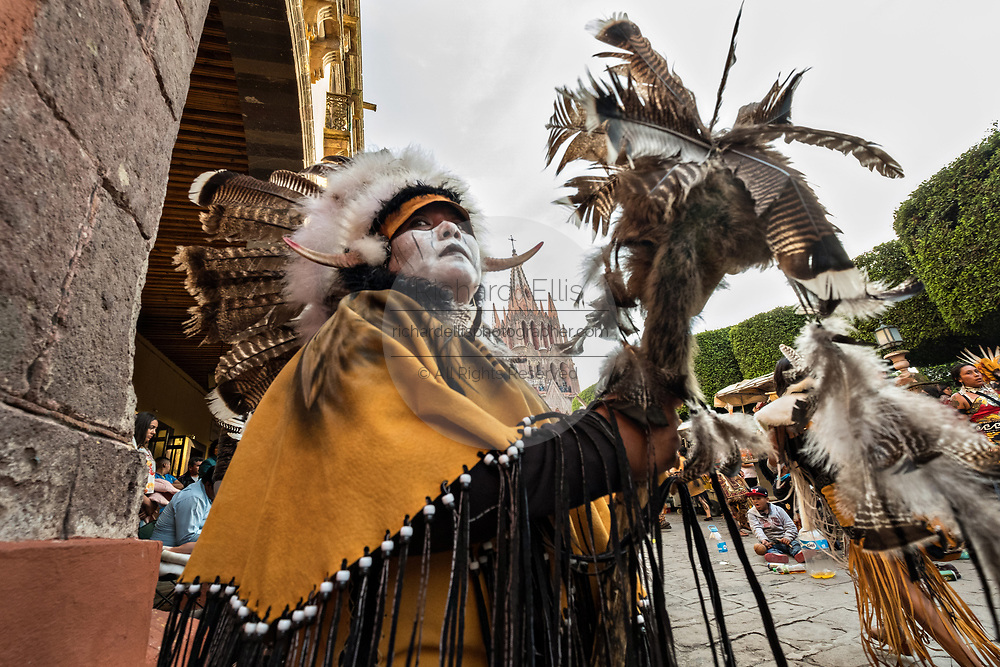 Mexican Concheros dance in a ceremony outside the Parroquia Church of Michael the Archangel during the week long fiesta of the patron saint Saint Michael October 1, 2017 in San Miguel de Allende, Mexico.