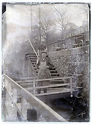vintage eroding glass plate with man and woman on bridge to their houseboat Paris 1900s