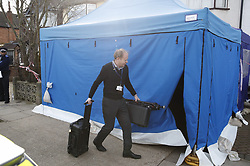 © Licensed to London News Pictures. 14/03/2018. London, UK. Forensics officers arrive at the house of Russian exile Nikolai Glushkov in south west London. Mr Glushkov, a friend of oligarch Boris Berezovsky, and a former deputy director of Russian state airline Aeroflot, died at his home in Monday night. Photo credit: Peter Macdiarmid/LNP