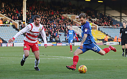 Danny Lloyd of Peterborough United shoots at goal past Matty Blair of Doncaster Rovers - Mandatory by-line: Joe Dent/JMP - 01/01/2018 - FOOTBALL - ABAX Stadium - Peterborough, England - Peterborough United v Doncaster Rovers - Sky Bet League One