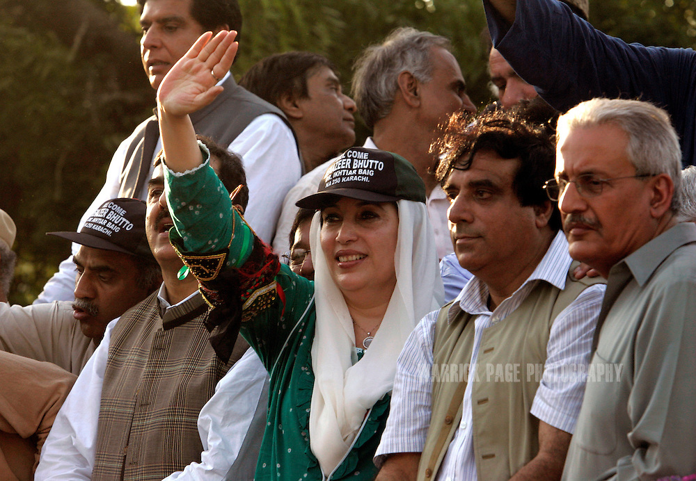 KARACHI, PAKISTAN - OCTOBER 18: Beazir Bhutto waves to her supporters, upon her arrival in Karachi, October 18, 2007, Karachi, Pakistan. At least 140 people were killed in a suicide bombing aimed at assassinating former prime minister and opposition leader, Benazir Bhutto. Bhutto was unharmed in the Karachi blast, only to be gunned down two months later by an unknown assassin at an election rally in the garrison city of Rawalpindi on December 27. Bhutto returned to Pakistan after 7 years in self-imposed exile on a US-brokered power-sharing deal with President Musharraf. The deal collapsed after Musharraf implemented emergency rule in November, arresting and imprisoning thousands of opposition members and lawyers. During her short-lived campaign, Bhutto had vowed to restore civilian leadership and democracy, and crush Islamic militancy throughout the country. (Photo by Warrick Page)