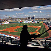 CUBS - DES MOINES, APRIL 13 --By late Thursday afternoon all of the snow was off the field, and an Iowa Cubs worker was busy sweeping away dust that had collected on the windows of the sky boxes at Principal Park.  The stadium was being spruced up for Friday's opening day game between the Cubs and Round Rock.   s0413cubs  DAVID PETERSON/THE REGISTERDes Moines, Ia., April 25, 2009 - DRAKE RELAYS PHOTOGRAPH BY DAVID PETERSON -