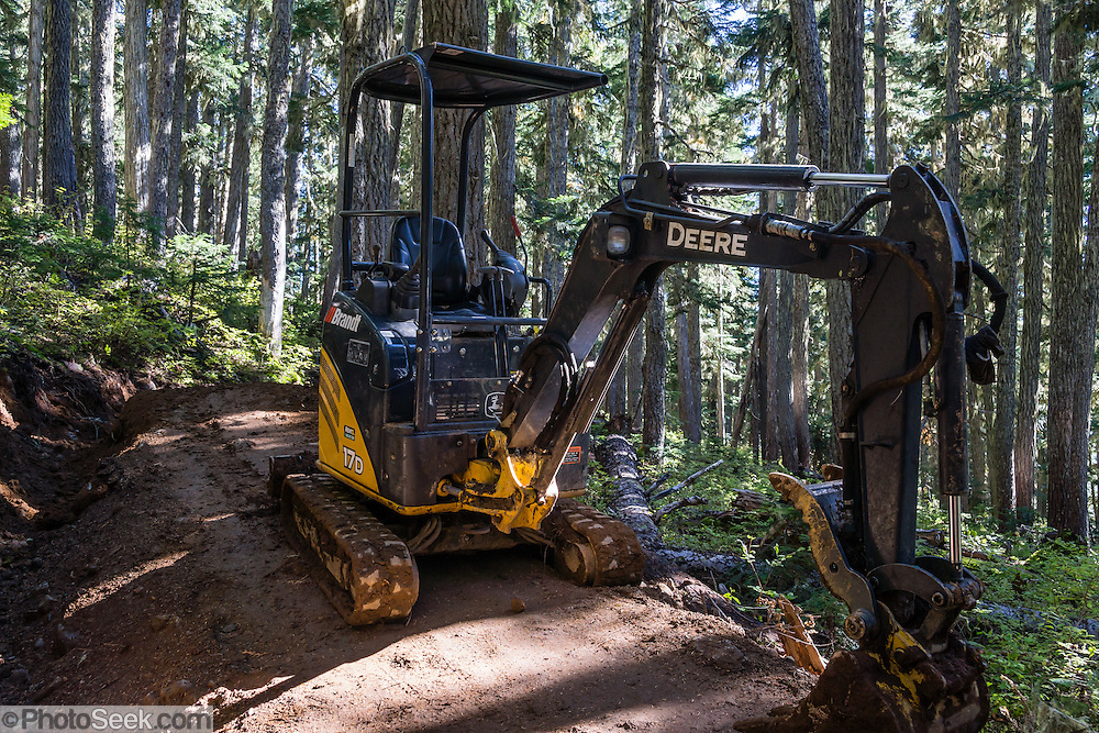 John Deere backhoe work on the forested trail from Taylor Meadows to Garibaldi Lake. Garibaldi Provincial Park, in the Coast Range, British Columbia, Canada. Garibaldi Park is east of the Sea to Sky Highway (Route 99) between Squamish and Whistler.