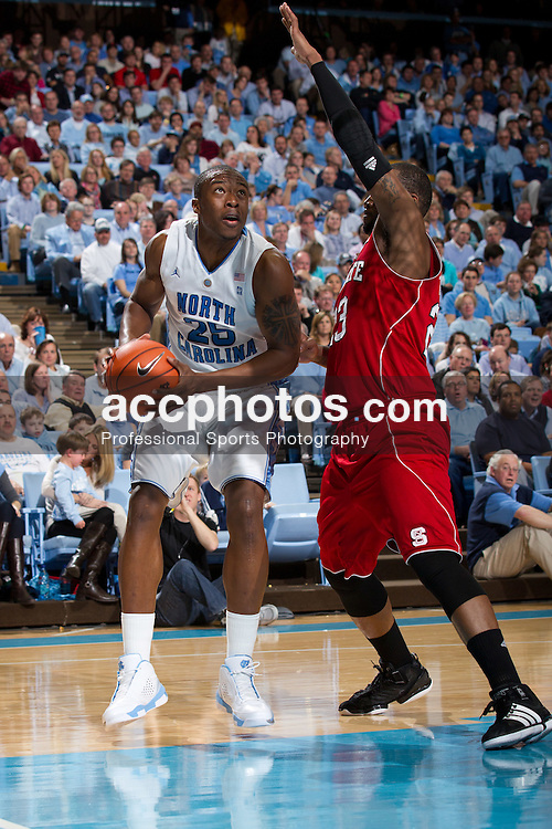 CHAPEL HILL, NC - JANUARY 29: Justin Knox #25 of the North Carolina Tar Heels looks to shoot around Tracy Smith #23 of the North Carolina State Wolfpack on January 29, 2011 at the Dean E. Smith Center in Chapel Hill, North Carolina. North Carolina won 84-64. (Photo by Peyton Williams/UNC/Getty Images)  *** Local Caption *** Justin Knox;Tracy Smith