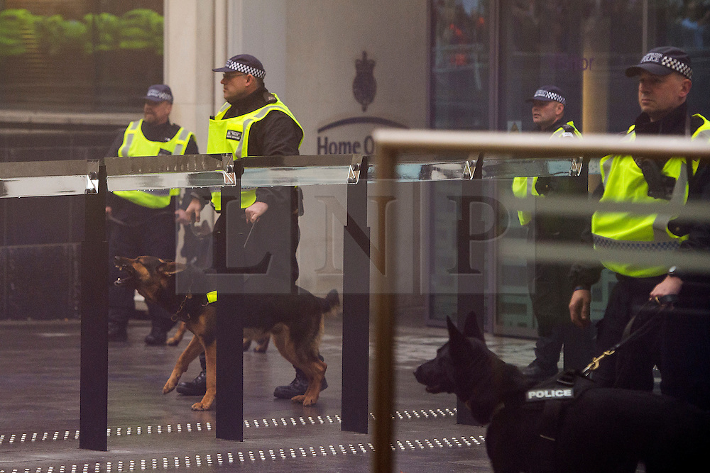 © Licensed to London News Pictures. 04/11/2015. London, UK.  Police with dogs guard the home office as Demonstrators clash with police as Thousands of students take part in a demonstration in central London against tuition fees. The rally which starts outside the University of London Union, will feature a speech from Shadow Chancellor John McDonnell.  Photo credit: Ben Cawthra/LNP