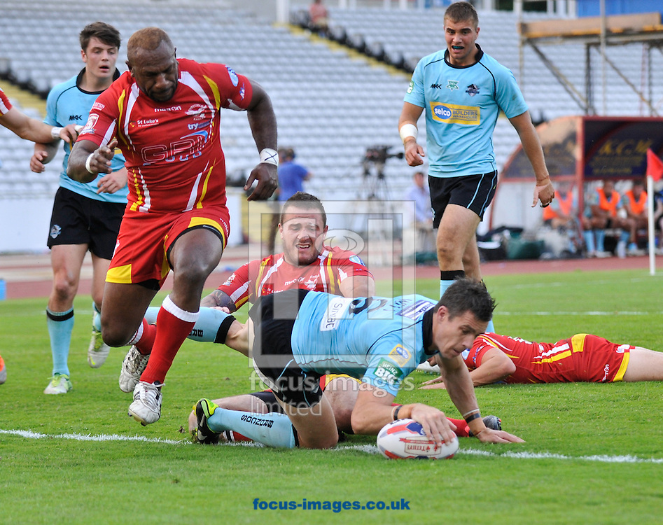 Picture by Richard Land/Focus Images Ltd +44 7713 507003<br /> 12/07/2013<br /> Michael Witt of London Broncos dives in to score the first try during the Tetley's Challenge Cup match at Don Valley Stadium, Sheffield .