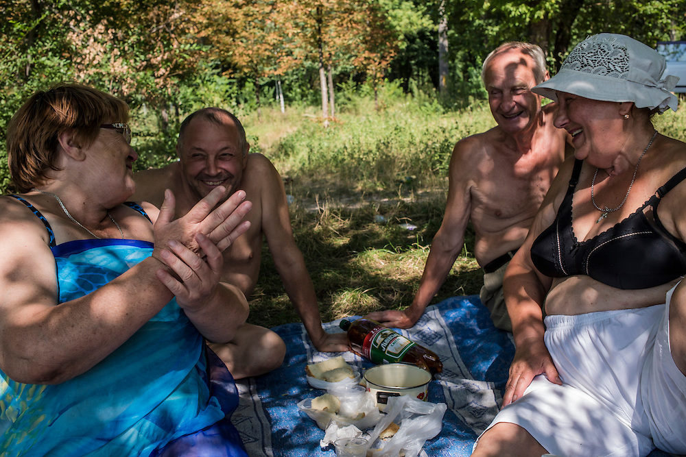 Retired local residents enjoy an afternoon at the beach on Sunday, July 27, 2014 in Donetsk, Ukraine.