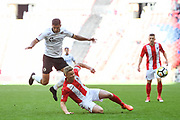 Omar Bugiel of Bromley FC (25) and Gareth Dean of Brackley Town (6) battle for the ball during the FA Trophy match between Brackley Town and Bromley at Wembley Stadium, London, England on 20 May 2018. Picture by Stephen Wright.