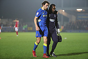 AFC Wimbledon defender Will Nightingale (5) going off injured during the EFL Sky Bet League 1 match between AFC Wimbledon and Charlton Athletic at the Cherry Red Records Stadium, Kingston, England on 10 April 2018. Picture by Matthew Redman.