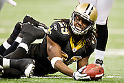 NEW ORLEANS, LA - DECEMBER 26:   Chris Ivory #29 of the New Orleans Saints on the ground after being tackled against the Atlanta Falcons at Mercedes-Benz Superdome on December 26, 2011 in New Orleans, Louisiana.  The Saints defeated the Falcons 45-16.  (Photo by Wesley Hitt/Getty Images) *** Local Caption *** Chris Ivory