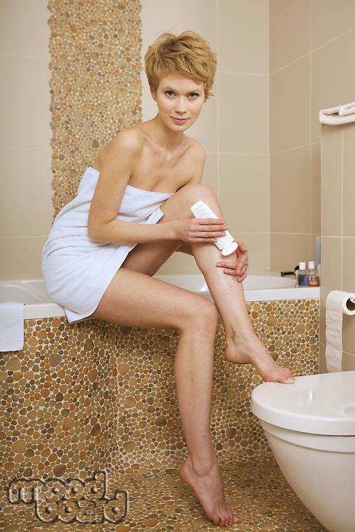 Woman shaving her leg