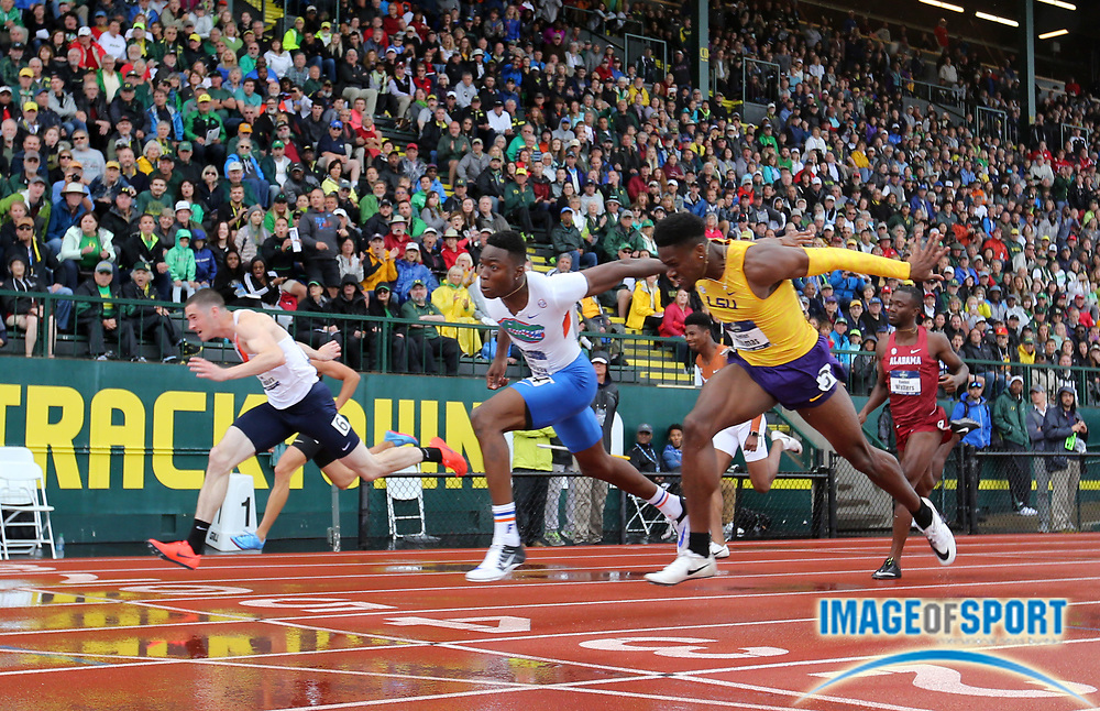 Jun 8, 2018; Eugene, OR, USA; Grant Holloway of Florida (center) defeats David Kendziera of Illinois (left) and Daniel Thomas of LSU to win the 110m hurdles in 13.42 during the NCAA Track and Field championships at Hayward Field. Kendziera was second in 13.43 and Thomas was third in 13.45.