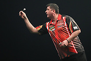 Mensur Suljovic during the PDC World Darts Championship at The MotorPoint Arena, Cardiff. Pictures taken by Shane Healey.