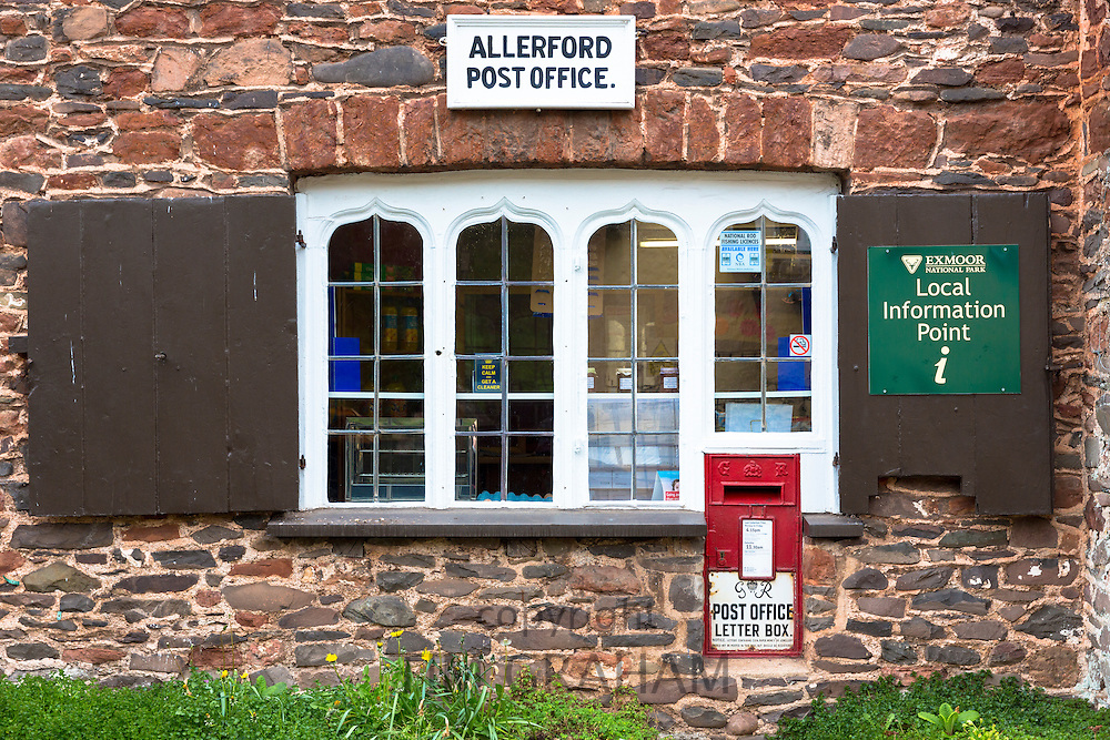 The Old Post Office and village shop with leaded light windows and postbox at Allerford on Exmoor, Somerset, United Kingdom