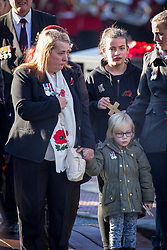 © Licensed to London News Pictures . 10/11/2013 . Bury , UK . LYN RIGBY (left). Family of Drummer (Private) Lee Rigby of the Royal Regiment of Fusiliers outside the church before the service . Remembrance Sunday service at Bury Parish Church , Greater Manchester today (Sunday 10th November 2013) . Photo credit : Joel Goodman/LNP