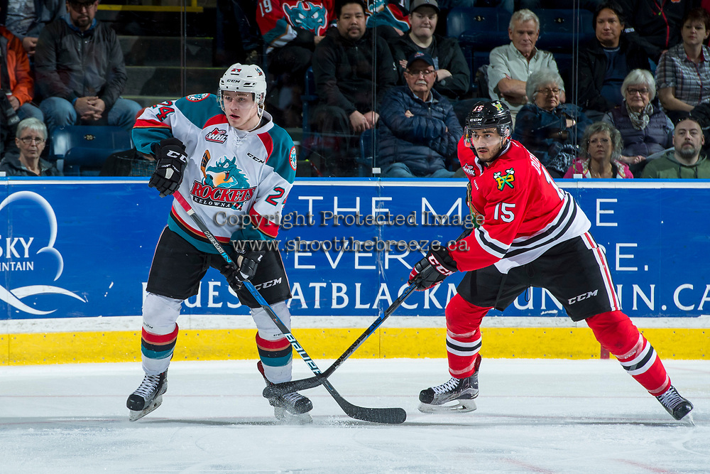 KELOWNA, CANADA - APRIL 14: Kyle Topping #24 of the Kelowna Rockets is stick checked by Shaun Dosanjh #15 of the Portland Winterhawks on April 14, 2017 at Prospera Place in Kelowna, British Columbia, Canada.  (Photo by Marissa Baecker/Shoot the Breeze)  *** Local Caption ***