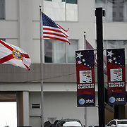 A torn American flag is seen outside a hotel during the Republican National Convention in Tampa, Fla. on Wednesday, August 29, 2012. (AP Photo/Alex Menendez)