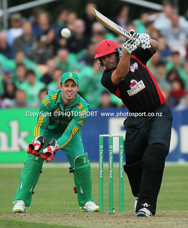 Matt McEwan batting for Canterbury, with South African wicket keeper AB de Villiers. Canterbury Wizards v South Africa. International Twenty20 cricket match, Hagley Oval, Wednesday 15 February 2012. Photo : Joseph Johnson / photosport.co.nz