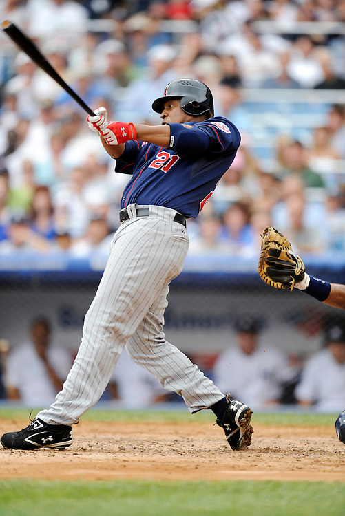 NEW YORK - JULY 23: Delmon Young #21 of the Minnesota Twins at bat against the New York Yankees during their game at Yankee Stadium on July 23, 2008 in the Bronx borough of New York City. The Yankees defeated the Twins 5 to 1(Photo by Rob Tringali/Sportschrome/Getty Images) *** Local Caption *** Delmon Young