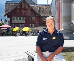 20.08.2012, Stadtbrunnen am Marktplatz, Dornbirn, AUT, EBEL, Dornbirner Eishockey Club, DEC Media Days 2012, im Bild Dave MacQueen, (Dornbirner Eishockey Club, Head Coach) im Hintergrund das Wahrzeichen von Dornbirn das rote Haus // during the DEC Media Days 2012 of Erste Bank Icehockey League Team, Dornbirner Icehockey club at the City, Dornbirn, Austria, 2012/08/20, EXPA Pictures © 2012, PhotoCredit: EXPA/ Peter Rinderer
