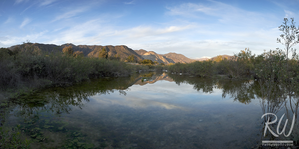 Scenic Panoramic of San Gabriel Mountains Reflection in Pool of Water at Encanto Park, Duarte, California