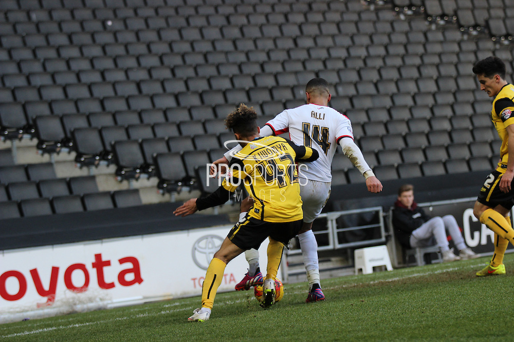 Dele Alli of MK Dons holds off Alex Kiwomya of Barnsley during the Sky Bet League 1 match between Milton Keynes Dons and Barnsley at stadium:mk, Milton Keynes, England on 24 January 2015. Photo by Josh Smith.