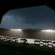 Rain falls during the game at Harvard Stadium on May 10, 2014 in Boston, Massachusetts. (Photo by Elan Kawesch)