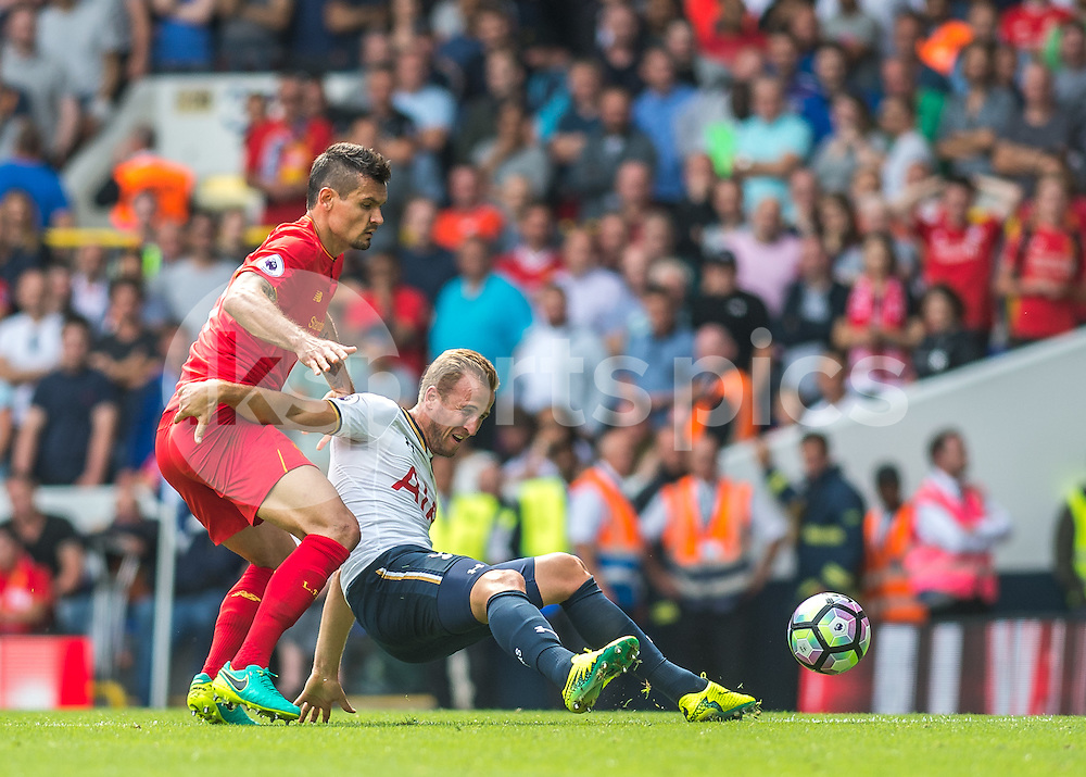 Dejan Lovren of Liverpool brings down Harry Kane of Tottenham Hotspur during the Premier League match between Tottenham Hotspur and Liverpool at White Hart Lane, London, England on 27 August 2016. Photo by Vince  Mignott.