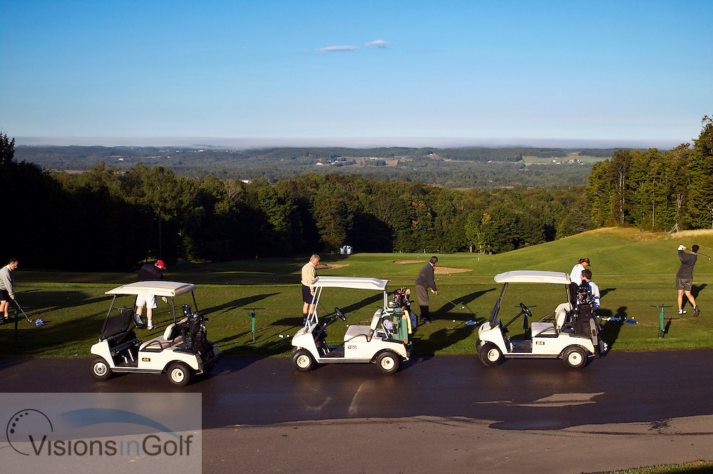 040910 Treetops resort Gaylord Michigan USA / Photo Christer H&circ;glund / Morning on the drivingrange at Treetops resort with buggys / carts lined up<br /> <br /> Photo Visions In Golf/Christer Hoglund