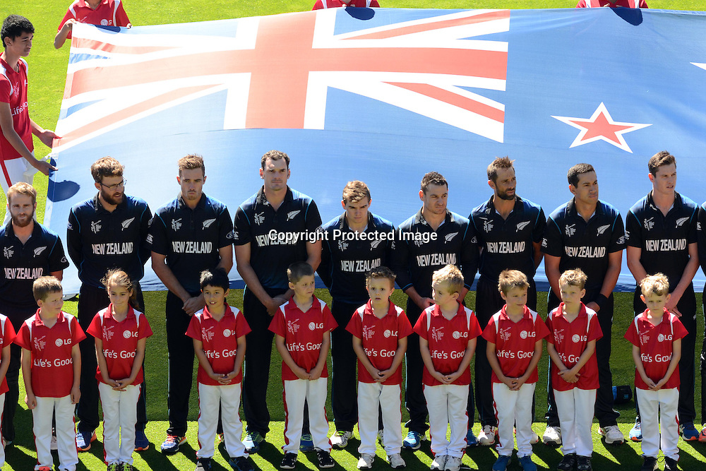 New Zealand players line up for their national anthem during the ICC Cricket World Cup Quaterfinal match between New Zealand and West Indies at Westpac Stadium in Wellington, New Zealand. Saturday 21  March 2015. Copyright Photo: Raghavan Venugopal / www.photosport.co.nz