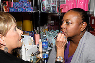 Carolyn Edwards of Dayton (right) gets a makeup touch-up from Julie Fair of Estee Lauder during the Dayton's Women Fair at the Airport Expo Center in Vandalia., Saturday, September 17, 2011.