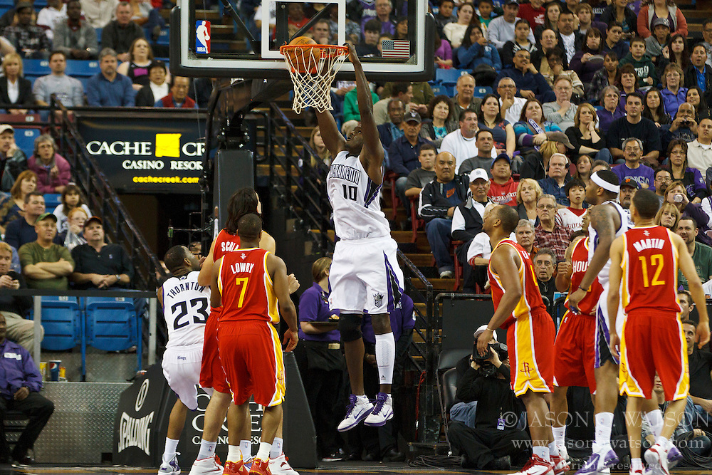 March 7, 2011; Sacramento, CA, USA;  Sacramento Kings center Samuel Dalembert (10) dunks against the Houston Rockets during the second quarter at the Power Balance Pavilion. Houston defeated Sacramento 123-101.