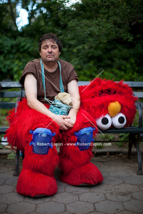 "Bad Elmo ""Luis"" in Central Park. . Photo by Robert Caplin"