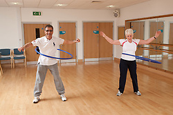 Older people doing exercise class.
