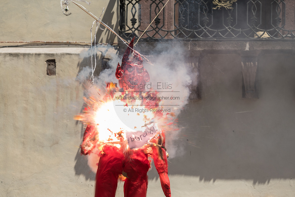 A paper doll effigy of the devil explodes during the Burning of Judas Easter-time ritual marking the end of Holy Week in the Plaza Allende April 1, 2018 in San Miguel de Allende, Mexico. The effigies are filled with fireworks and explode to the entertainment of the crowd in a good natured symbolic renewal and clearing out demons.