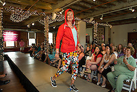 Sue Gaudette from Gunstock Mountain Resort brightens up the runway in her vibrant selection from Nike during the Fashion and Flair Show at the Belknap Mill on Sunday afternoon.  (Karen Bobotas/for the Laconia Daily Sun)
