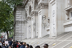 © Licensed to London News Pictures. 03/06/2020. London, UK. (BLM) Black Lives Matter has been spray painted onto the front of The Foreign Office building in Whitehall during a demonstation following the death of African American George Floyd while in police custody. The death of George Floyd, who died after being restrained by a police officer In Minneapolis, Minnesota, has caused widespread rioting and looting across the USA. Photo credit: Peter Macdiarmid/LNP