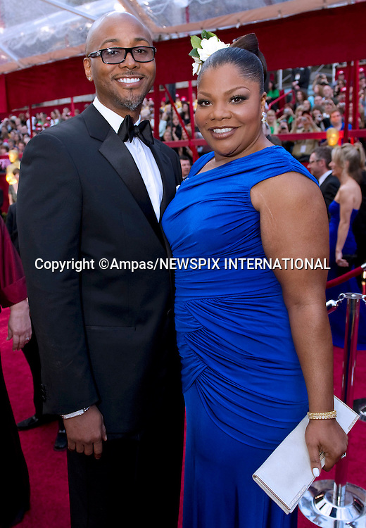 "MO'NIQUE AND SIDNEY HICKS.arrives at the 82nd Annual Academy Awards at the Kodak Theatre in Hollywood, CA, on Sunday, March 7, 2010..Mandatory Photo Credit: Newspix International..**ALL FEES PAYABLE TO: ""NEWSPIX INTERNATIONAL""**..PHOTO CREDIT MANDATORY!!: NEWSPIX INTERNATIONAL(Failure to credit will incur a surcharge of 100% of reproduction fees)..IMMEDIATE CONFIRMATION OF USAGE REQUIRED:.Newspix International, 31 Chinnery Hill, Bishop's Stortford, ENGLAND CM23 3PS.Tel:+441279 324672  ; Fax: +441279656877.Mobile:  0777568 1153.e-mail: info@newspixinternational.co.uk"