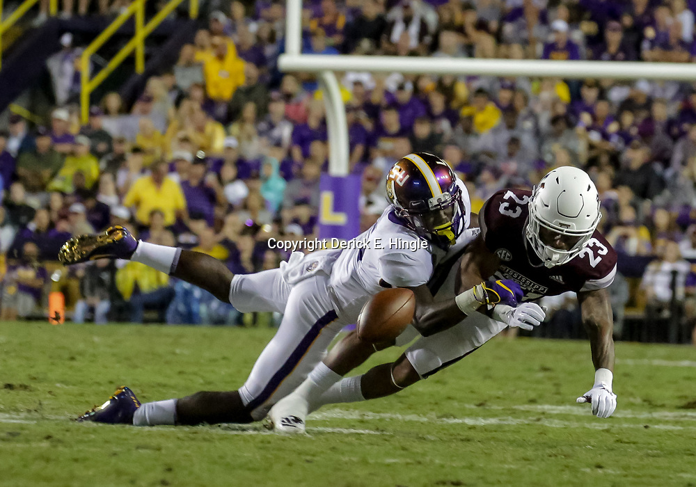 Oct 20, 2018; Baton Rouge, LA, USA; LSU Tigers cornerback Kary Vincent Jr. (5) breaks up a pass to Mississippi State Bulldogs wide receiver Keith Mixon (23) during the second half at Tiger Stadium. LSU defeated Mississippi State 19-3. Mandatory Credit: Derick E. Hingle-USA TODAY Sports