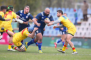 USA player Paul Lasike runs through some Romanian tacklers in the first half during the November Test match between Romania and USA at Ghencea Stadium, Bucharest, Romania on 17 November 2018.