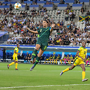 GRENOBLE, FRANCE June 18. Sam Kerr #20 of Australia scores her second goal of the match heading past goalkeeper Nicole McClure #13 of Jamaica during the Jamaica V Australia, Group C match at the FIFA Women's World Cup at Stade des Alpes on June 18th 2019 in Grenoble, France. (Photo by Tim Clayton/Corbis via Getty Images)