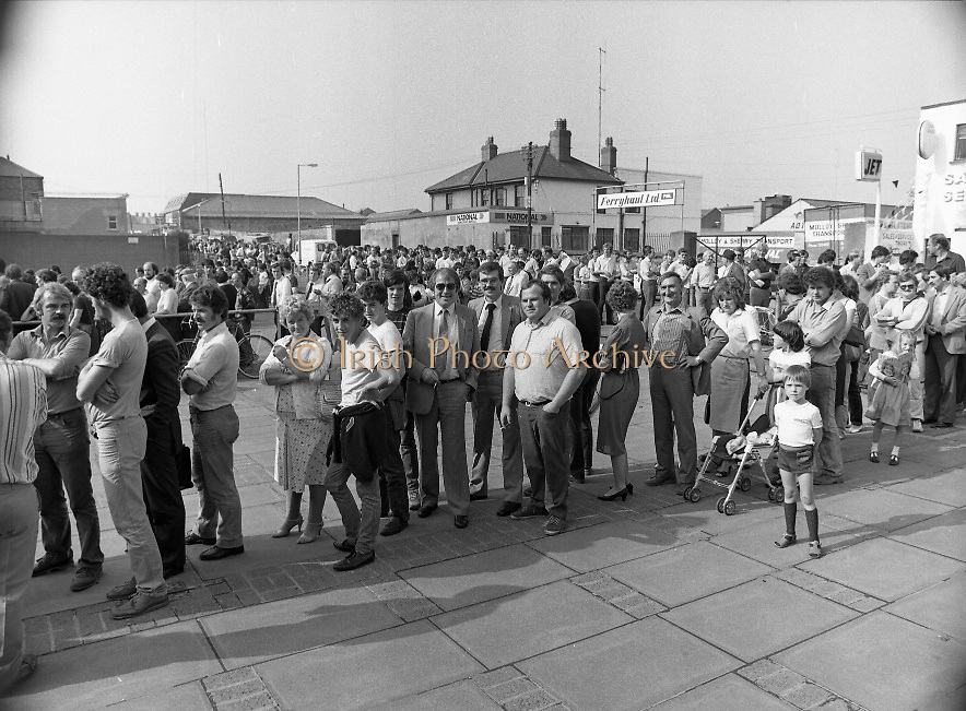 Croke Park Ticket Queues.1983.28.08.1983.08.28.1983.28 August 1983..Image taken as thousands of Dubliners queue to capture vital All Ireland Replay Tickets. The replay Between Dublin and Cork was to be held in Cork. The queue calmly waits in the hope of securing tickets...Note: Dublin beat Cork in a very exciting encounter and the went on to beat Galway 1.10 to 1.08 in the final at Croke Park.