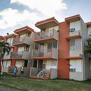 The apartment building where Kimberly Torres, 21, lives in Guayama, Puerto Rico. Torres is pregnant with her second child. Right now, Zika is spreading rapidly in Puerto Rico and pregnant women are at risk for becoming infected with Zika which can cause microcephaly and other birth defects. If the current trends continue, at least 1 in 4 people, including women who become pregnant, may become infected with Zika.