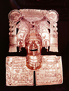 Aztec god of the dead, Mitlantecuhtli, represented in 15th century gold pendant, one of the few gold ornaments which escaped being turned into bullion by the Spanish conquistadors